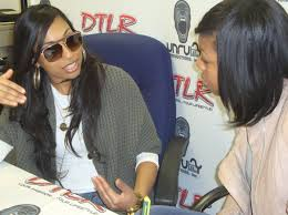 Courtney interviewing singer Melanie Fiona
